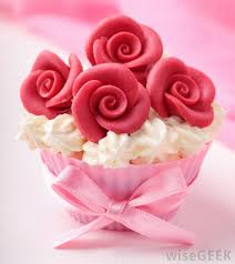 A Cupcake Decorated With Marzipan Roses