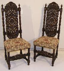 A Pair Of 19th Century Oak High Back Hall Chairs In The Jacobean ... Rare Antique 19th Century American Gothic Handcarved Solid Oak High Back Black Leather Upholstered His Her Throne Chairs Vintage Handcarved Cane Highback Hooded Chair Set Of 8 62 Arts And Crafts Carved Oak Ding Chairs High For Kitchen Table Spanish Conquistador Contemporary Carved Wood Side 43 Sandy Brown Linen Natural Cedar Accent 31092775 About Us Italian Renaissance Style 20th Cent Mahogany Throne Chair With Lion Arms A Back Crest Stretcher Brown Country Armchair C Spning Bedroom Seating Russian Arm Newel Bishops Occasional Blue Lion