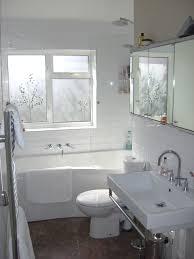white acrylic corner bathtub decor with white subway tile ceramic