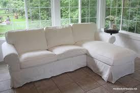 finished white sofa hooked on houses