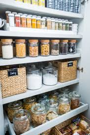 Organised Pantry Using Clever Storage Solutions Such As Baskets Jars And Clear Containers