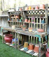 Old And Rustic DIY Potting Bench With Storage Floating Shelf Made From Reclaimed Wood Beside Fence Ideas