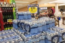 Flint Resident Miesha Woodley 13 Grabs A Case Of Water In Kroger Wednesday