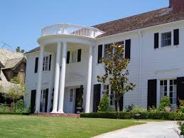 Colonial Homes by Brown Front Door Ideas And White Column Brick Wall Plus Great Look