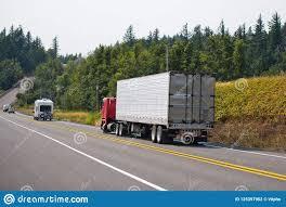 Red Big Rig Cab-over Semi Truck Transporting Cargo In Refrigerat ...