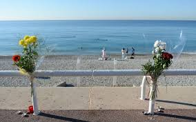 Flowers Are Tucked To A Fence Near The Spot Where Someone Was Killed On Promenade Des