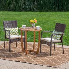 Alex Outdoor 3 Piece Acacia Wood/ Wicker Bistro Set With Cushions, Teak  Finish And Brown With Crème Americana Wicker Bistro Table And Chairs Set Plowhearth Royalcraft Cannes Brown Rattan 3pc 2 Seater Cube Breakfast Ceylon Outdoor 3piece By Christopher Knight Home Hampton Bay Aria 3piece Balcony Patio Sirio Valentine Swivel Ellie 3 Piece Folding Fniture W Round In Dark Outdoor Cast Alinium Rattan Ding Sets Georgina With Cushions Wilko Effect