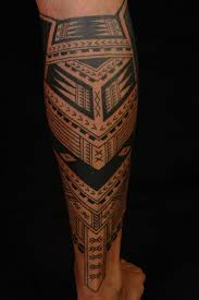 Man With Polynesian Sun Tattoo On Legs