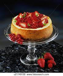 Stock graphy Strawberry And Red Currant Cheesecake Glass Cake Stand Black Background
