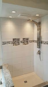 bathroom remodel with shower glass accent tile and new