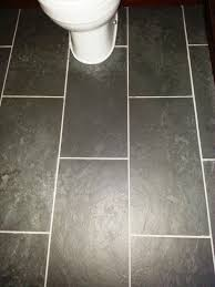 dealing with limescale stains on a slate tiled bathroom in