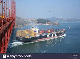 100 Shipping Containers San Francisco Container Ship Passing Under Golden Gate Bridge Stock