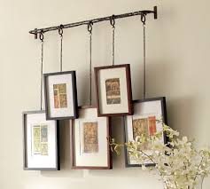 Alternative chain for hanging frames clip boards on a wall or