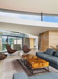 Family Room Addition Ideas by Solid Wooden Coffee Table With Grey Colored Sofa For Modern Family