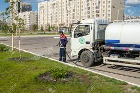 Big Green Lawn Care In Astana City Stock Photo, Picture And Royalty ...