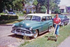 1950s Ford And Plymouth