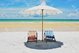 Twin Beach Chair On The Sea Background Stock Photo, Picture And ...