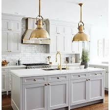 grey kitchen cabinets and brass light fixtures kitchens