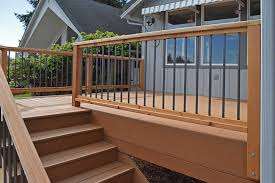 The Railings On This Composite Deck Use Thin, Metal Slats To Add ... Best 25 Deck Railings Ideas On Pinterest Outdoor Stairs 7 Best Images Cable Railing Decking And Fiberon Com Railing Gate 29 Cottage Deck Banister Cap Near The House Banquette Diy Wood Ideas Doherty Durability Of Fencing Beautiful Rail For And Indoors 126 Dock Stairs 21 Metal Rustic Title Rustic Brown Wood Decks 9