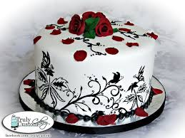 I decided to do a design in black white and red that was sharp and crisp Because that s how I see her The design on the side of the cake was painted