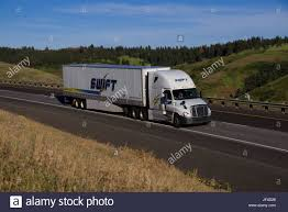 SWIFT Transportation / Rural Oregon, USA Stock Photo: 147000848 - Alamy Swift Knight Shareholders Approve Mger Truck Trailer Transport Express Freight Logistic Diesel Mack Transportation 4 Axle Freightliner Columbia With New Flickr Traportations Driverfacing Cams Could Start Trend Fortune Cascadia Evolution Truc Fileswift Flatbed Coloradojpg Wikimedia Commons Phone Companies Trucking Company Number Top 5 Largest In The Us 50th Anniversary Cascadi On Twitter What A Great Truck From Our