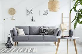 real photo of a scandi living room interior with cushions on gra photo by bialasiewicz on envato elements