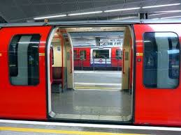 Central Line train doors open both sides