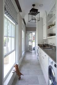 Great Mudroom Laundry Room Design Featuring Quartz Countertop And Natural Stone Floor Tiles Lighting