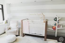 nursery with striped walls contemporary nursery
