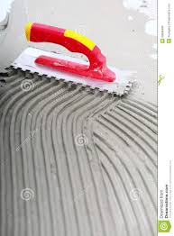 construction notched trowel with mortar for tiles work stock image