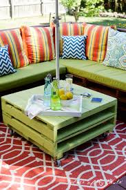 Colorful Cushions On Diy Pallet Patio Furniture With Sectional Bench And Rustic Green Coffee Table