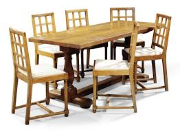 A HEAL SON LTD OAK DINING TABLE AND CHAIRS