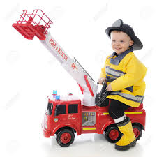 An Adorable Toddler Boy Happily Riding A Toy Firetruck In His ... Fire Truck Electric Toy Car Yellow Kids Ride On Cars In 22 On Trucks For Your Little Hero Notes Traditional Wooden Fire Engine Ride Truck Children And Toddlers Eurotrike Tandem Trike Sales Schylling Metal Speedster Rideon Welcome To Characteronlinecouk Fireman Sam Toys Vehicle Pedal Classic Style Outdoor Firetruck Engine Steel St Albans Hertfordshire Gumtree Thomas Playtime Driving Power Wheel Truck Toys With Dodge Ram 3500 Detachable Water Gun
