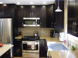 Black Merillat Cabinets With Silver Oven And Sink Faucet Chandelier For Kitchen Decor Inspiration