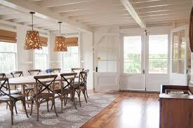 Tropical Themed Area Rugs Dining Room Beach Style With Harwood Floors White Wall