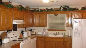 Interesting Kitchen With Above Cabinet Decor