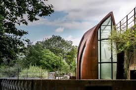 Wrapped By A Weathered Corten Steel Exterior Shell The Building Currently Combines Family Home And Photography Studio Communal Areas Are Placed At