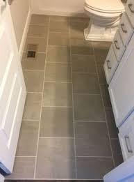 floor for all bathrooms except level dal tile emblem gray