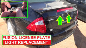how to replace the license plate light bulb on ford fusion 2009