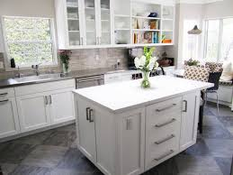 interior grey tile backsplash connected by white wooden kitchen