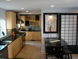 U Shaped Kitchen Decor With Natural Color Furnitures And Black Stools Also Hidden Bottle Storage In