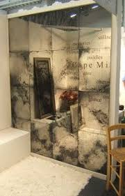 a feature wall in antique mirror glass the desk the