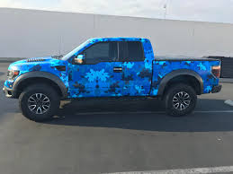 Ford Raptor: Blue Camo - Full Sail Graphics Vehicle Graphics Wraps Advertising Promotional Products 1625 John Brady Kryptek Vinyl Rofull Size Cmyk Grafix Store Camo Truck Car Wrap City Black Digital Rocker Panel Wrapped In Skinswrapped Skins Wheel Well Camo Grass Camouflage Decals Camowraps Wrapping Prices Quotes Local Wrappers Custom Military Green Digi Ideas Graphic Decal Kit Jeepsuv Kryptek Kits Grafics Unlimited