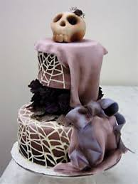 Gorgeous Three Tier Blakc And White Goth Style Wedding Cake Decorated With Black Sugar Paste