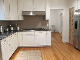 what color cabinets with wood floors floors white
