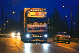 Download Nighttime DAF XF Flower Truck And City Lights Editorial Image