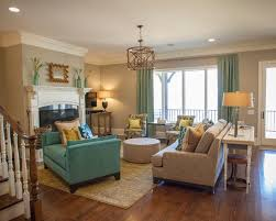 Teal Living Room Ideas by Lucy And Company Oatmeal Sofa Patterned Chairs Curtains Ottoman