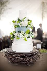 Some Long Twigs Or Twine Through A Simple Glass Plate Rusty Clear Coated Metal That Creates An Intriguing Barn Accent Piece For Your Cake Display