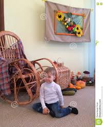 Boy Sitting On The Floor Next To The Rocking Chair Stock ... Rocking Chair For Nturing And The Nursery Gary Weeks Coral Coast Norwood Inoutdoor Horizontal Slat Back Product Review Video Fort Lauderdale Airport Has Rocking Chairs To Sit Watch Young Man Sitting On Chair Using Laptop Stock Photo Tips Choosing A Glider Or Lumat Bago Chairs With Inlay Antesala Round Elderly In By Window Reading D2400_140 Art 115 Journals Sad Senior Woman Glasses Vintage Childs Sugar Barrel Album Imgur Gaia Serena Oat Amazoncom Stool Comfortable Cushion