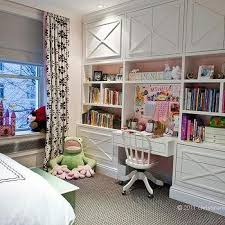 room with white lacquered built in desk with wallpapered pin